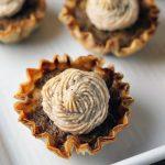 closeup of mini sweet potato pie with cinnamon cream cheese frosting