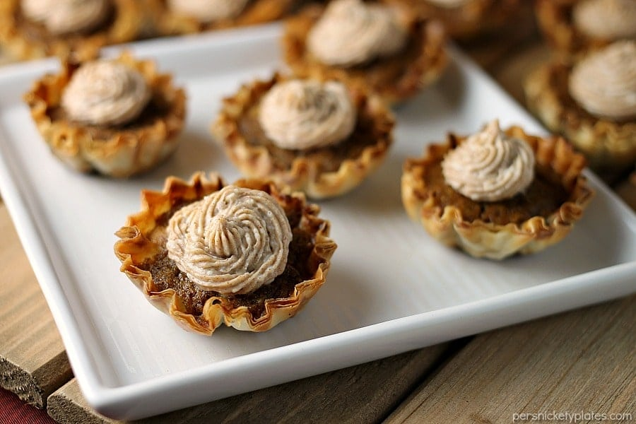 close up of 5 mini sweet potato pies on white square plate
