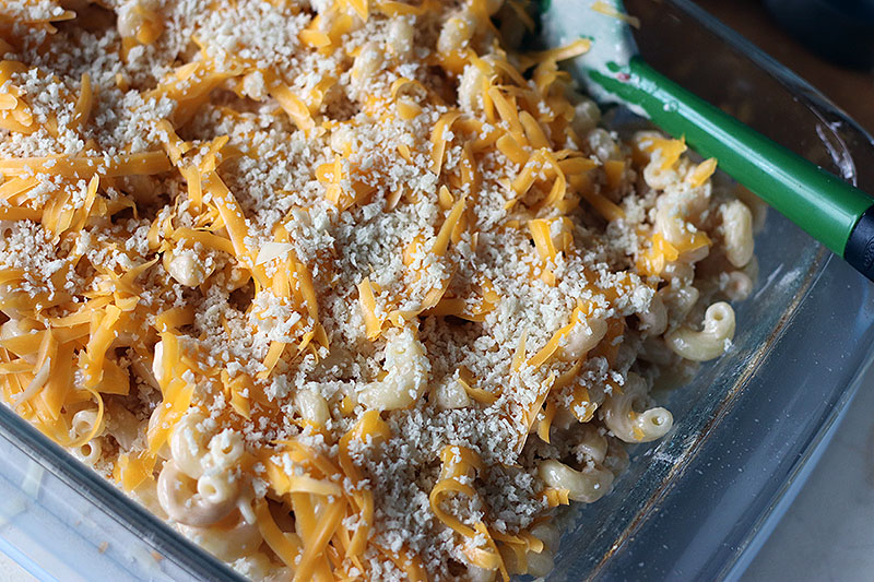 cheese and panko topping on baked mac and cheese in baking dish