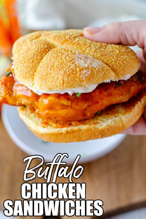 hand holding a buffalo chicken sandwich