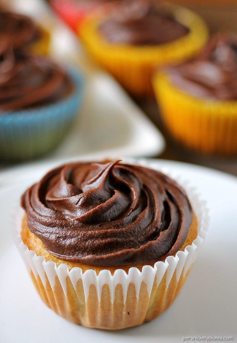 Cheesecake Filled Cupcakes are super simple starting with a cake mix but filled with chocolate chip cheesecake mixture in the centers! | www.persnicketyplates.com