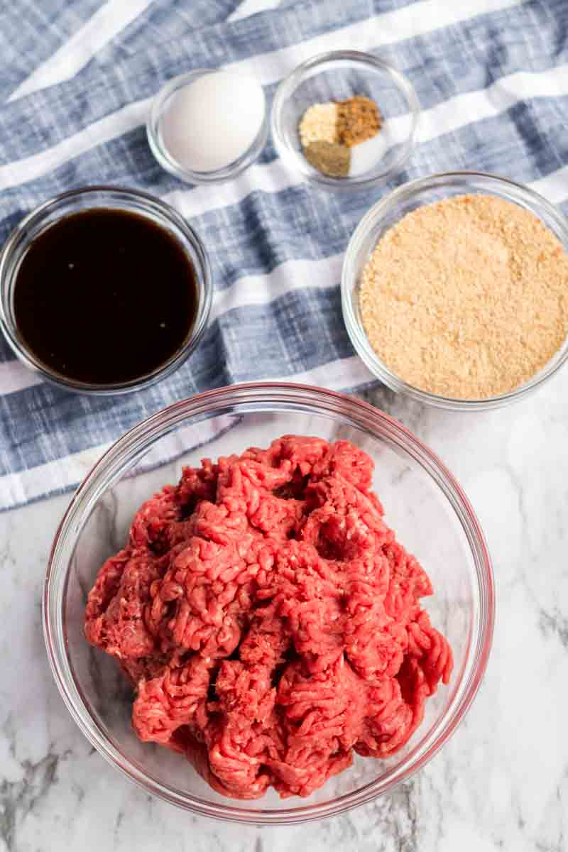 ground sirloin and seasonings prepped to make meatloaf