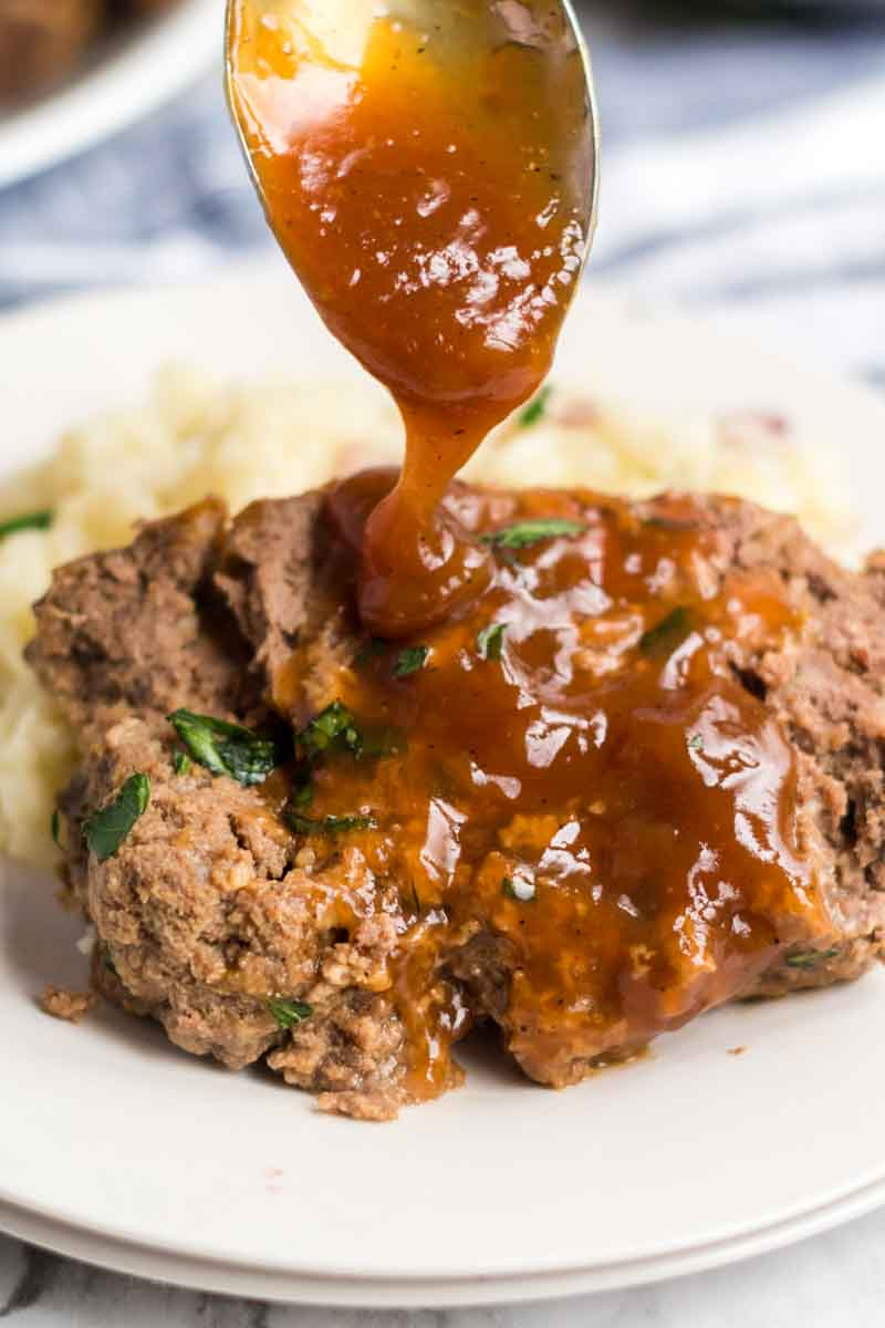 Classic Meatloaf with Brown Gravy for those nights you're feeling nostalgic and want an easy, filling meal. | www.persnicketyplates.com