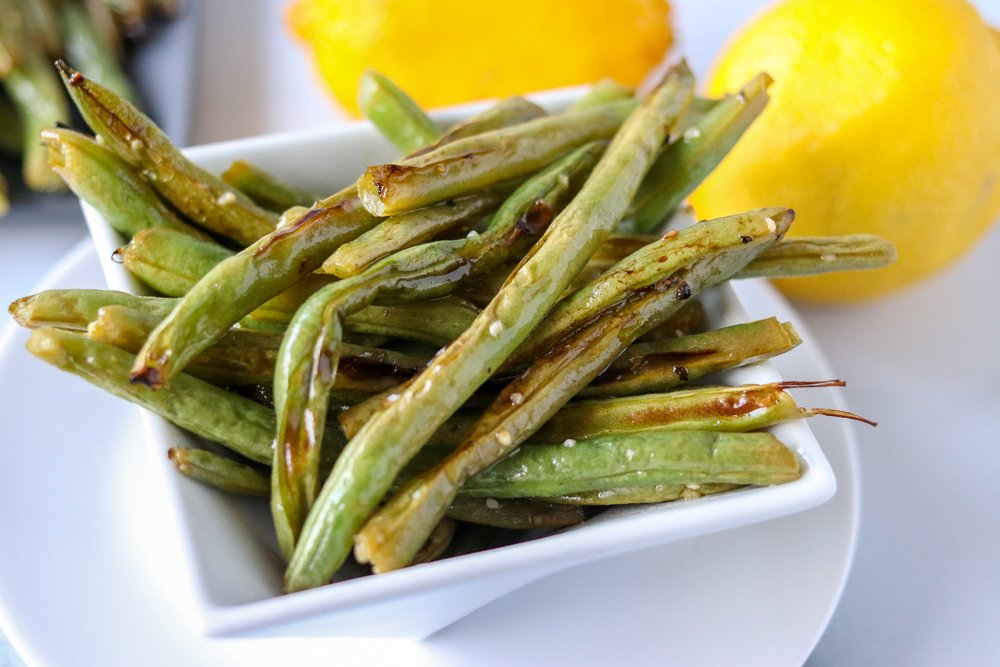 oven roasted garlic green beans in white plate
