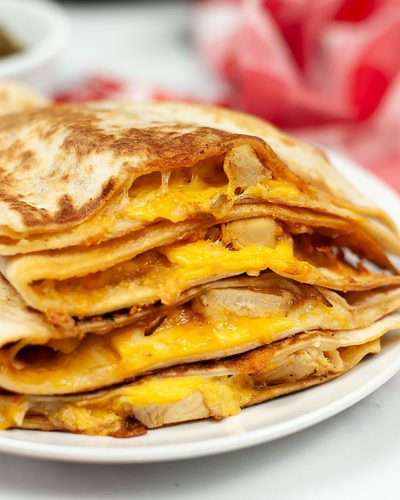 taco bell copycat quesadilla on a white plate with red napkin