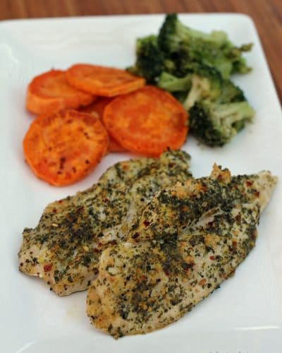 Simple baked chicken with garlic, basil and parsley that's full of flavor and make an easy weeknight dinner option.