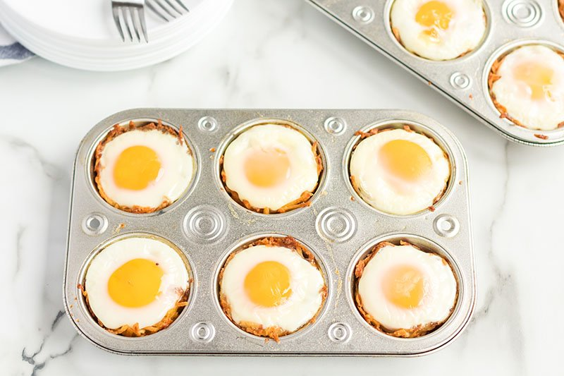 bird's nest breakfast cups in a muffin tin