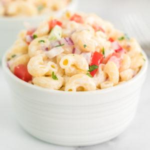 white bowl of classic macaroni salad