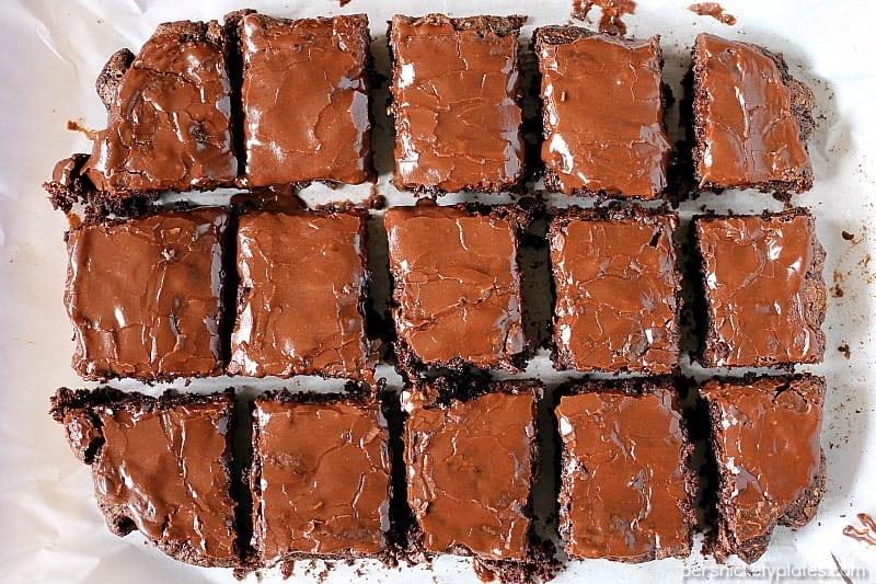 Zucchini Brownies are moist and chocolaty with a simple frosting. They also happen to be dairy-free/vegan. You'll never know there's zucchini hidden in them! | www.persnicketyplates.com