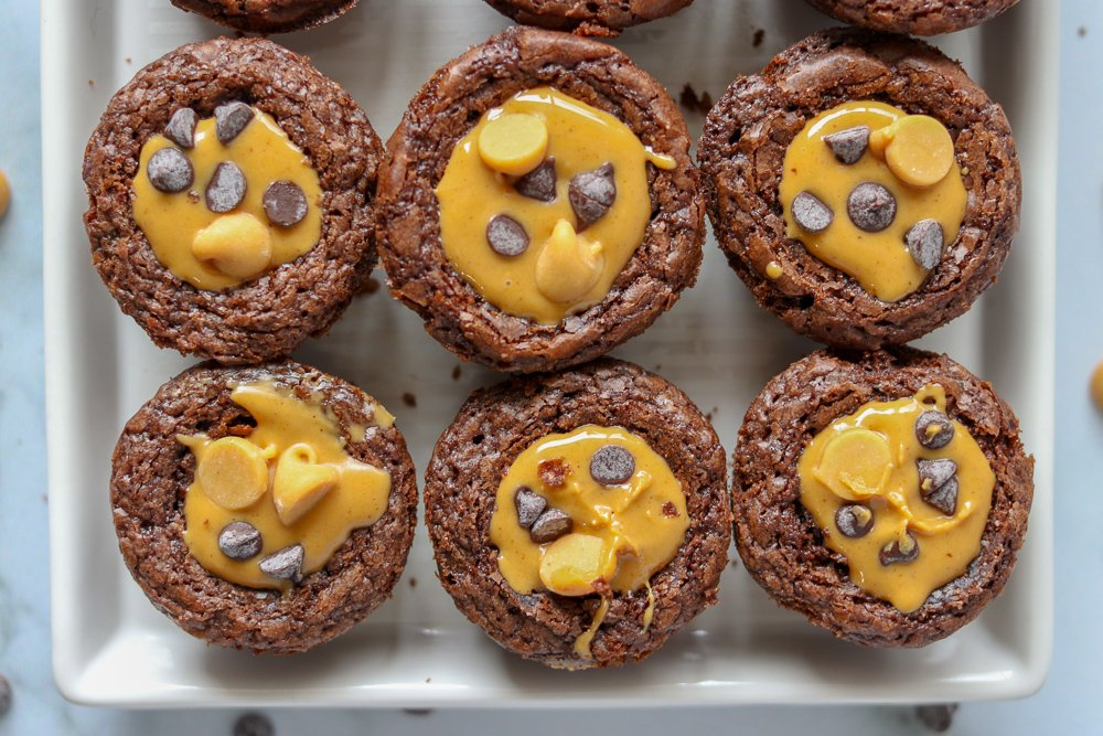 six brownie bites topped with peanut butter and chocolate chips
