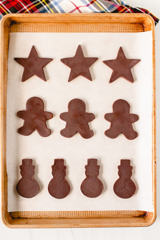 chocolate shaped cookies on a baking sheet