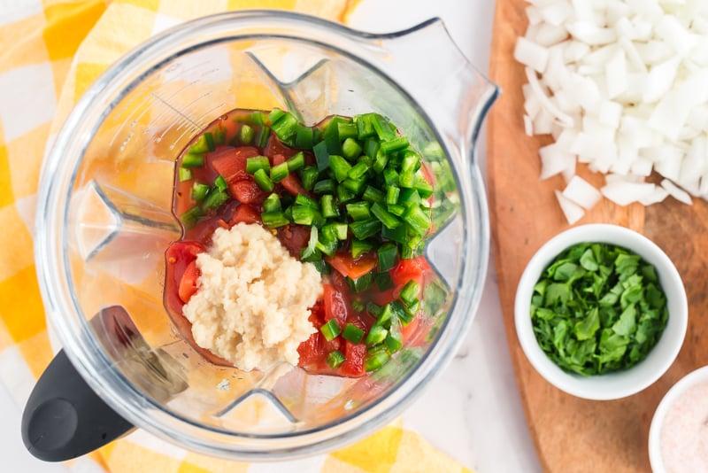 overhead shot of salsa ingredients in blender