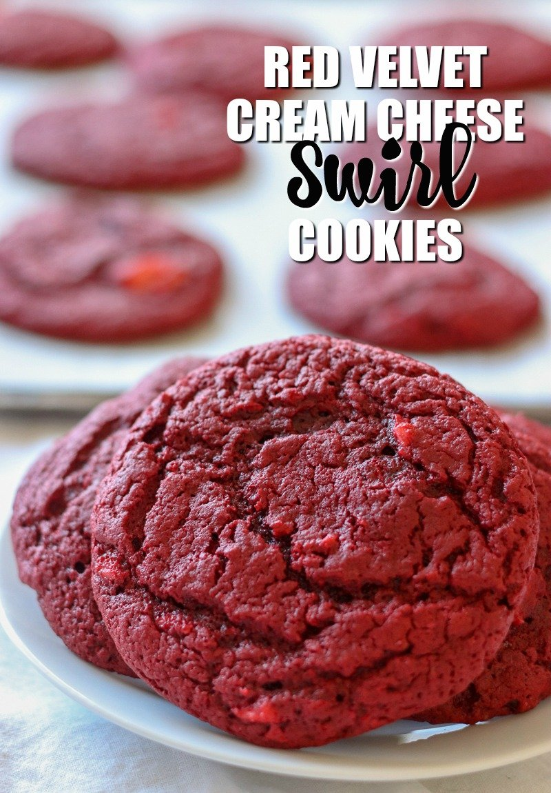 red velvet cream cheese swirl cookies on white plate with cookies in background