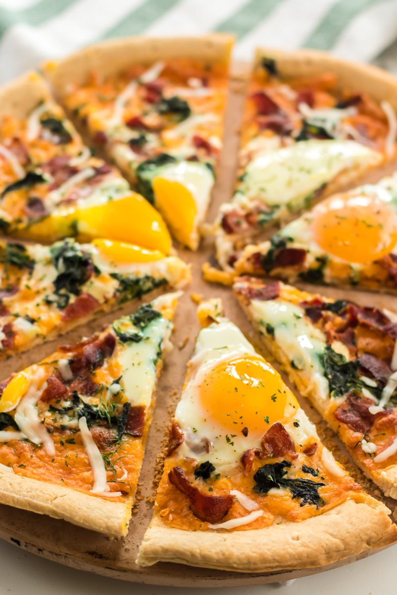 close up of sliced breakfast pizza