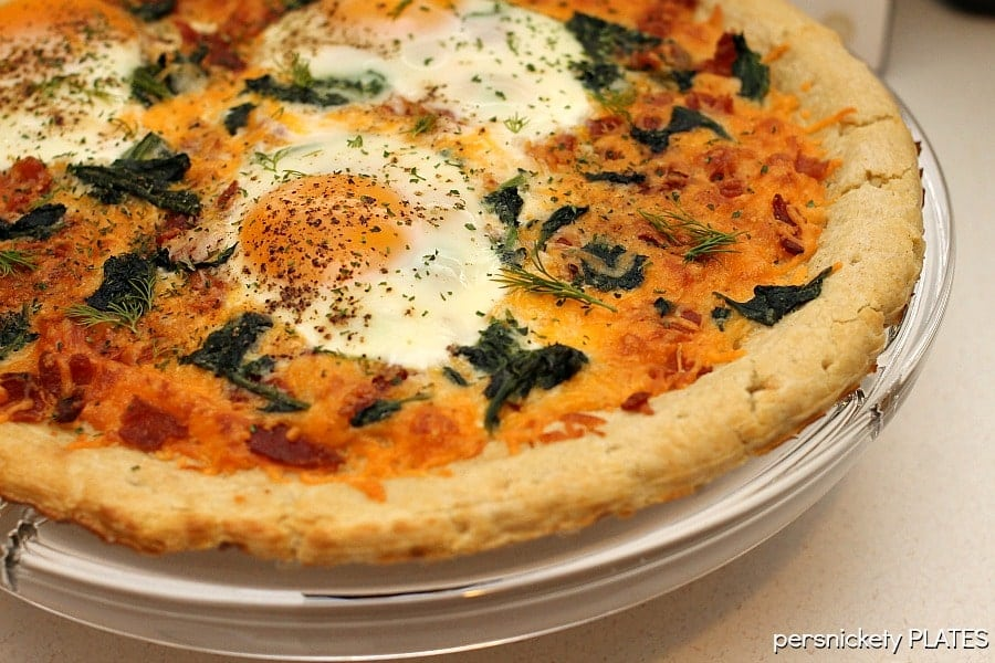 breakfast pizza on stand