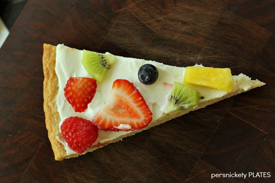 """Sugar Cookie Fruit Pizza -a thin sugar cookie """"crust"""" spread with a cream cheese """"sauce"""" and topped with strawberries, raspberries, kiwi, blueberries, pineapple - whatever fruit you love!"""