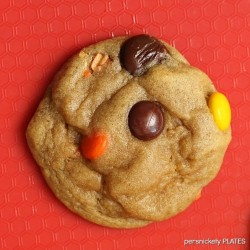 close up reese's pieces cookie on a red mat