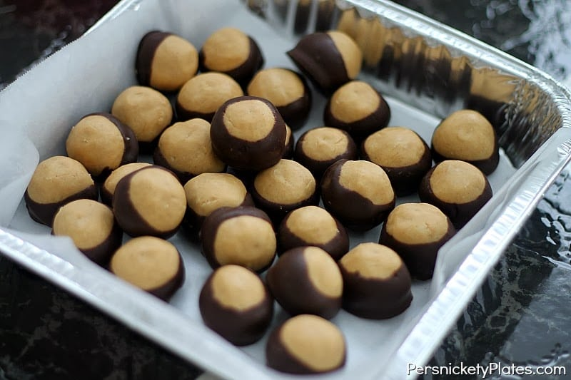 tray of chocolate dipped peanut butter balls