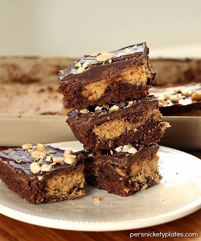 Classic brownies stuffed with Nutter Butters, frosted, then sprinkled with peanuts | Persnickety Plates