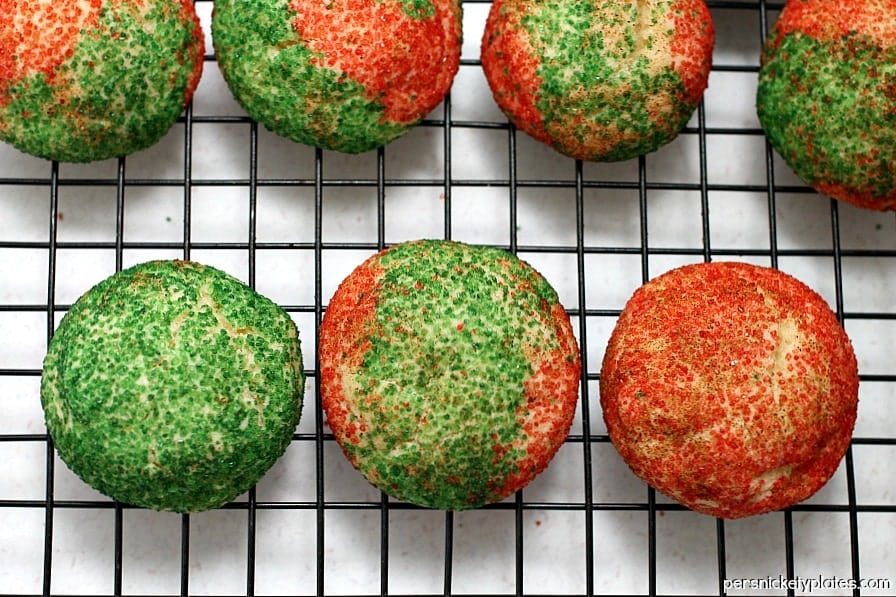 red and green snickerdoodles on a wire cookie rack