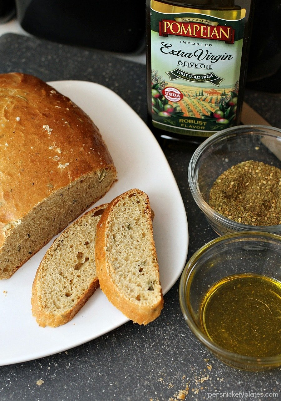 Rosemary Olive Oil Bread is light and flavorful and easy to make. This homemade bread is perfect served warm with a pat of creamy butter. Nothing much is better than fresh baked bread.