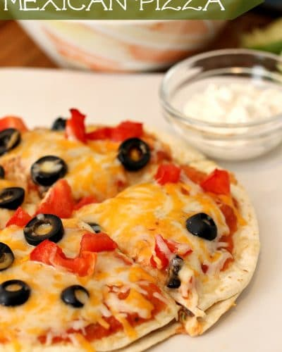 mexican pizza on a white plate