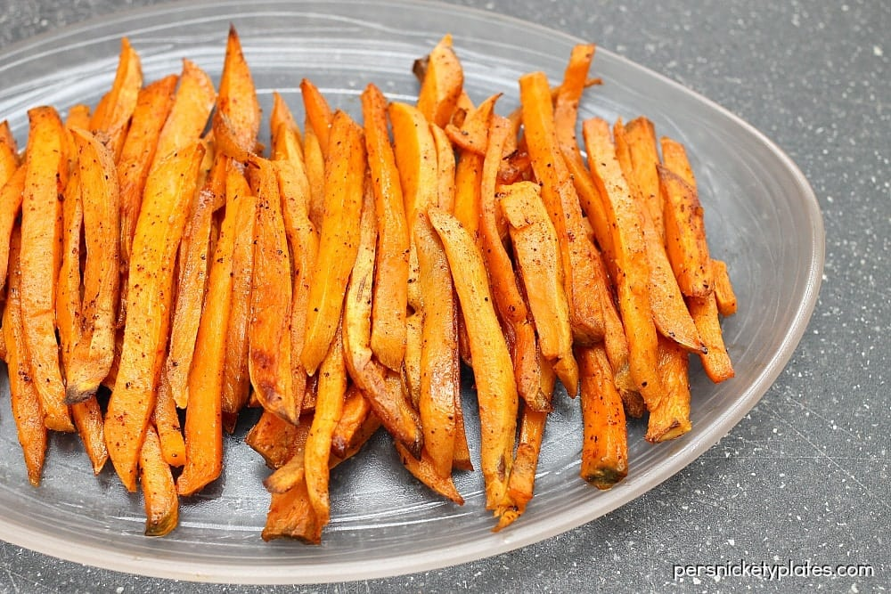 One of my favorite side dishes/snacks - oven baked sweet potato fries with a little kick of chili powder! | www.persnicketyplates.com