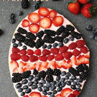 "A festive Easter egg sugar cookie fruit ""pizza"" with strawberry cream cheese frosting. You can make it super simple with a sugar cookie mix or make it from scratch. 