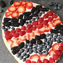 """A festive Easter egg sugar cookie fruit """"pizza"""" with strawberry cream cheese frosting. You can make it super simple with a sugar cookie mix or make it from scratch. 