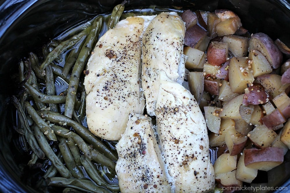 Chicken and Potatoes are comfort foods you love.  Make this Slow Cooker Chicken and Potatoes with Green Beans dish as a healthy meal everyone loves!