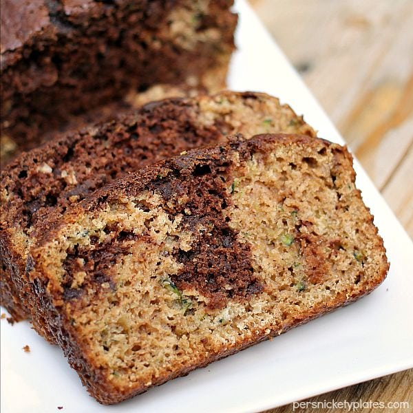 sliced chocolate marble zucchini bread on a white platter