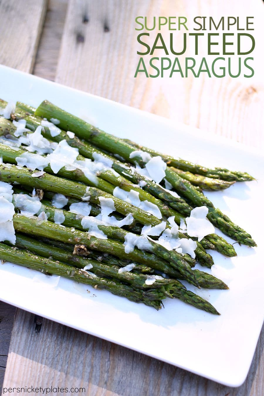 asparagus on a white plate sprinkled with cheese