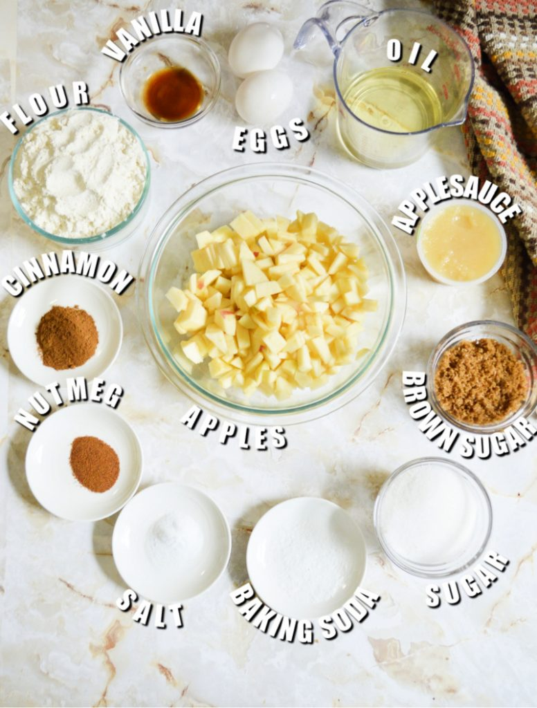 overhead shot of ingredients laid out in bowls to make apple bundt cake
