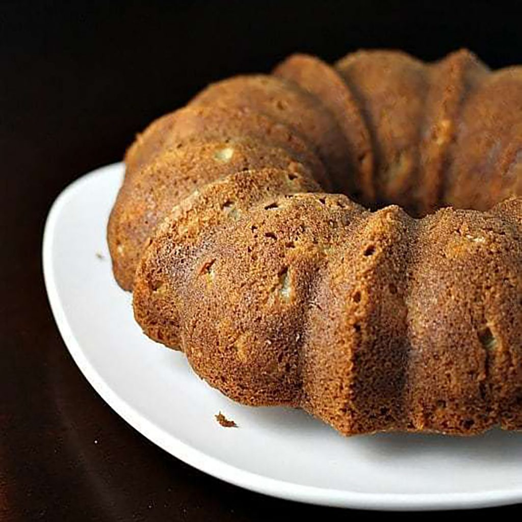 apple bundt cake on white platter