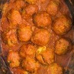 overhead shot of turkey meatballs in red sauce in crockpot