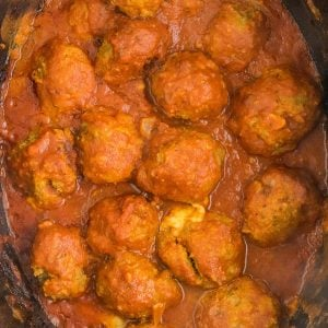 overhead shot of turkey meatballs in red sauce in crockpot