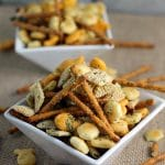 Ranch Cocktail Party Crackers - a blend of ranch flavored pretzels, goldfish, chex, oyster crackers, etc. Mix it up to include your favorites & it's perfect to munch on at parties! | Persnickety Plates