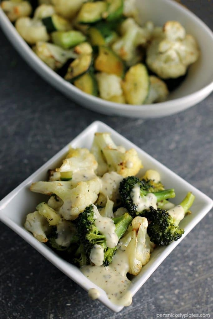 Simple blend of roasted broccoli, cauliflower, and zucchini flavored with dollops of Marzetti Lemon Basil finishing sauce. | Persnickety Plates AD