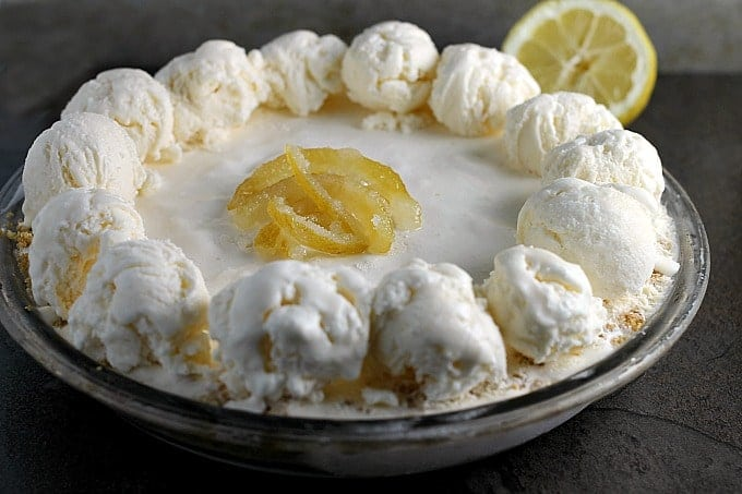 Lemonade Ice Cream Pie is nearly no bake (it can be if you take a shortcut with store bought crust!) and perfect for hot summer days. The tart lemonade flavor is balanced by the sweet graham cracker crust and creamy ice cream base.