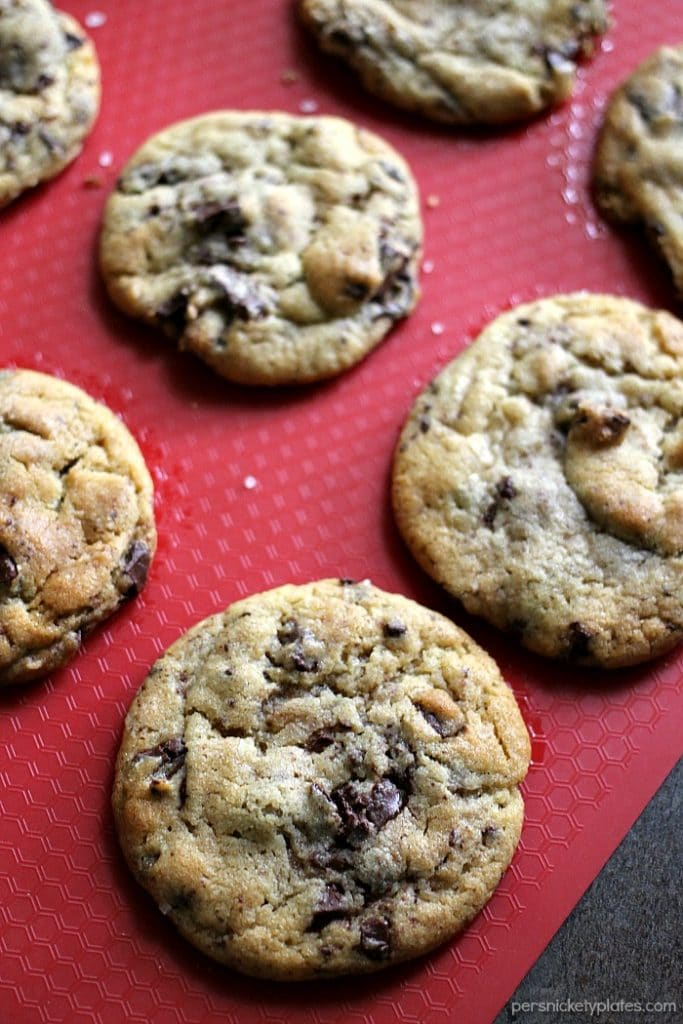 chocolate chip cookies on a red silicone mat