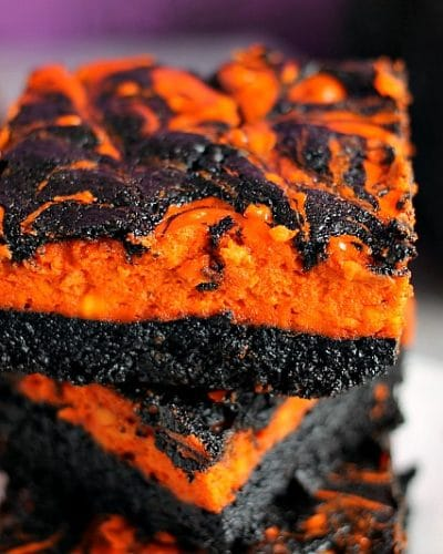 Halloween Cream Cheese Swirl Brownies have a layer of rich, dark chocolate brownie topped with a layer of orange cheesecake then swirled together for a spooky treat.   Persnickety Plates