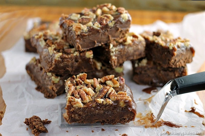 Salted Chocolate Caramel Bars start with a layer of chocolate shortbread, topped with a thick layer of homemade salted caramel, and finished off with toasted pecans.   Persnickety Plates
