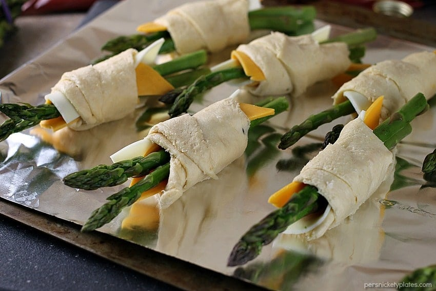 asparagus puffs prepped on a baking sheet ready for the oven