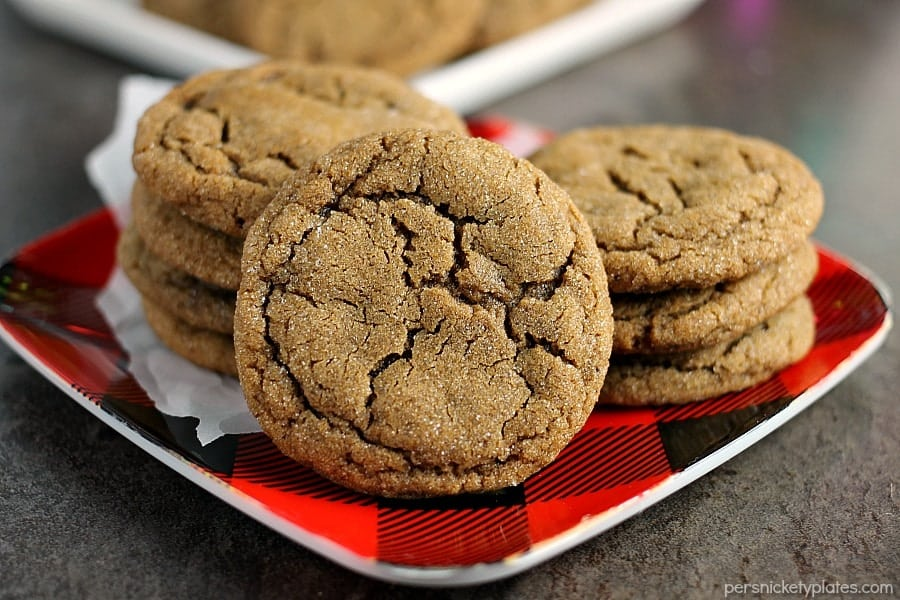close up of ginger snap cookie with stack of cookies in background
