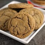 close up of ginger snap cookies on white plate