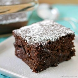 slice of chocolate cake topped with powdered sugar