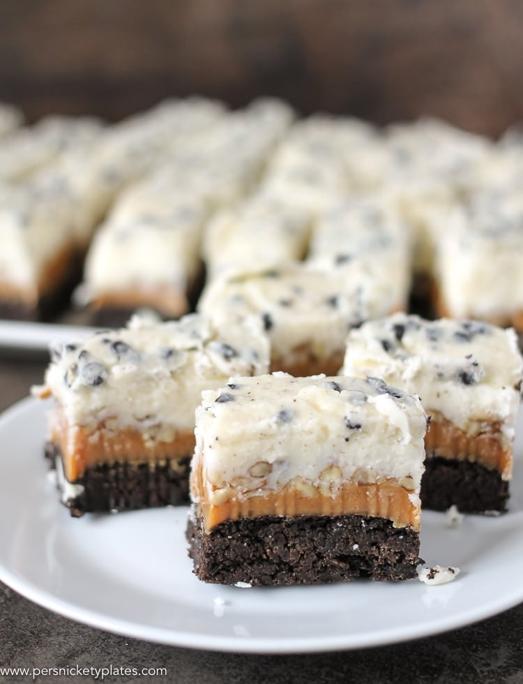 three cookies and cream caramel layer bars on a plate