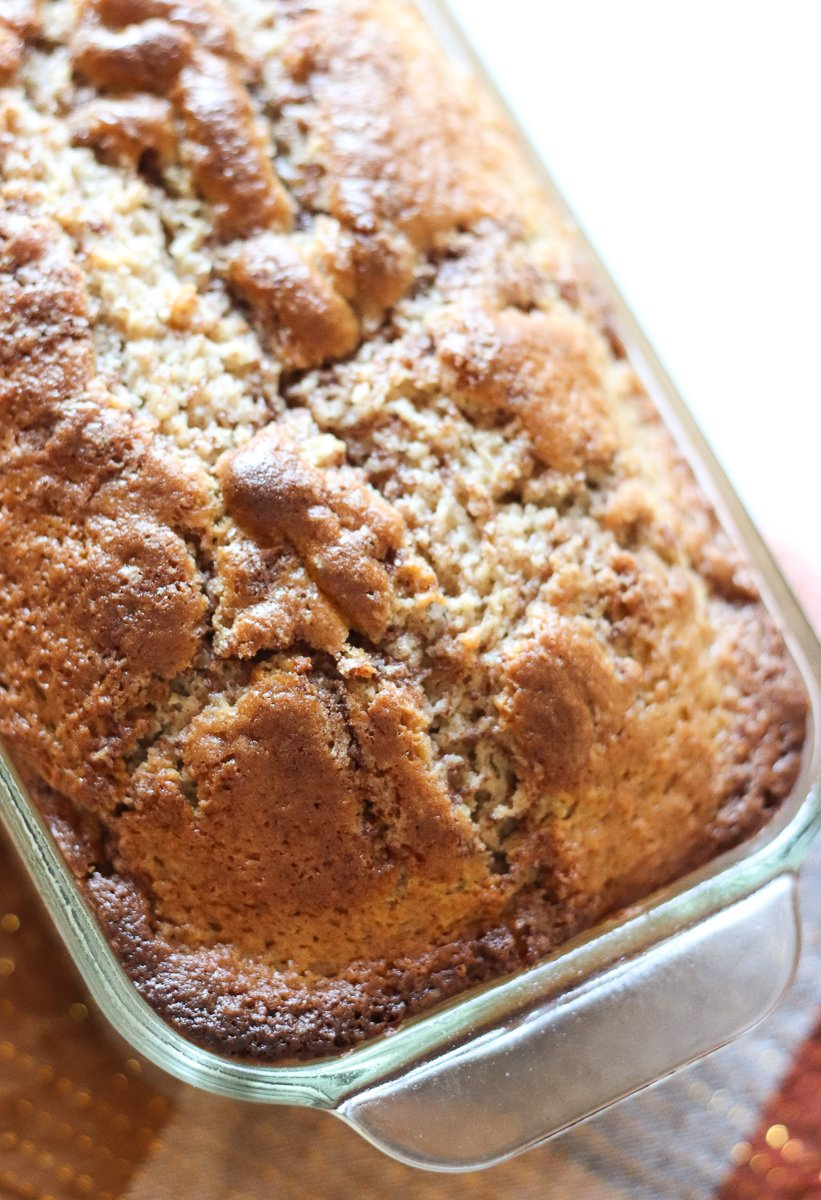loaf of cinnamon quick bread in a glass loaf pan