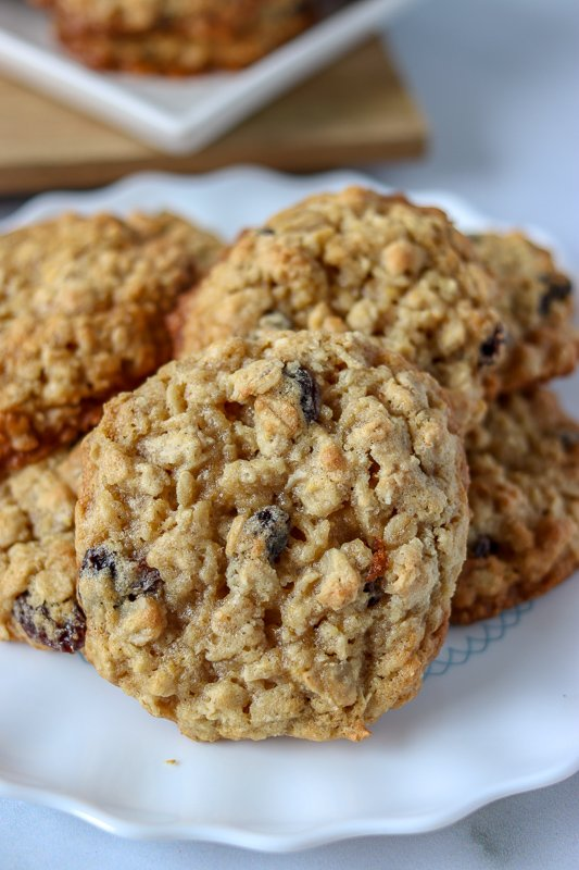 white plate with oatmeal raisin cookies