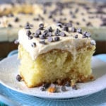 close up of cannoli poke cake topped with mini chocolate chips
